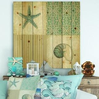Designart 'Beach Treasures Collage II' Traditional Bathroom Print on Natural Pine Wood - Blue