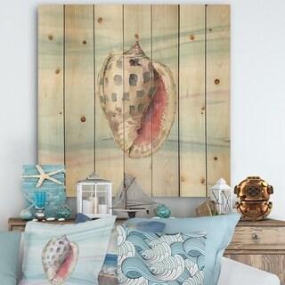 Designart 'Gilded Sea Horn Shell on Blue' Nautical & Coastal Print on Natural Pine Wood - Blue