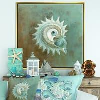 Designart 'Seashell Treasures from the Sea III' Nautical & Coastal Framed Canvas - Blue