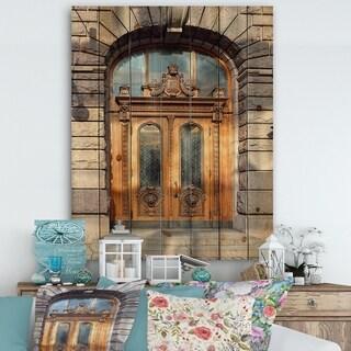 Designart 'Antique Door with Lion Shaped Knockers in Helsinki, Finland' Vintage Print on Natural Pine Wood - Multi-color