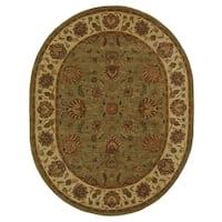 Safavieh Handmade Heritage Traditional Kerman Green/ Gold Wool Rug (4'6 x 6'6 Oval)