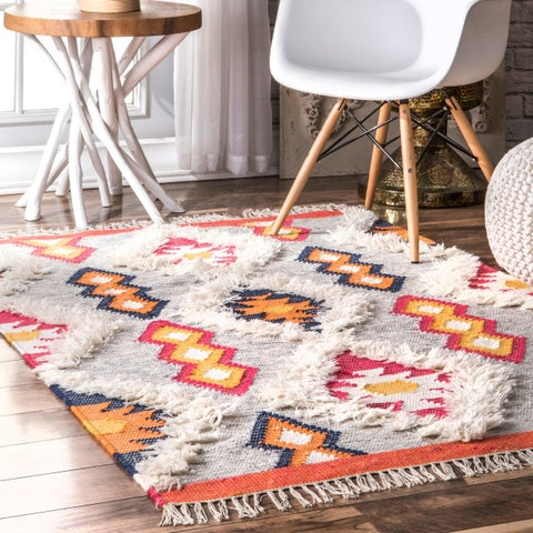 The Curated Nomad Sarria Hand-woven Wool Aztec Diamond Shaggy Area Rug