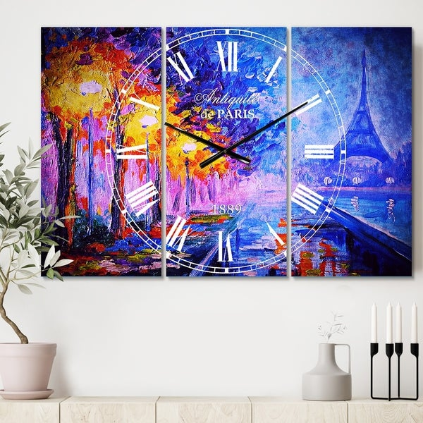 Designart 'View of Paris Eiffel Tower' Cottage 3 Panels Oversized Wall CLock - 36 in. wide x 28 in. high - 3 panels