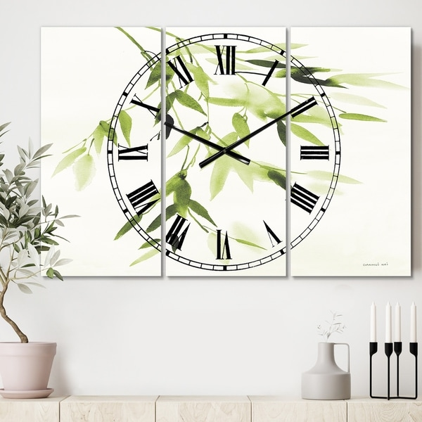 Designart 'Simplist Bamboo Leaves I' Cottage 3 Panels Oversized Metal Clock - 36 in. wide x 28 in. high - 3 panels