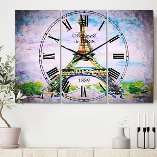 Designart 'Paris Eiffel Toweragainst Blue Sky' Cottage 3 Panels Large Wall CLock - 36 in. wide x 28 in. high - 3 panels