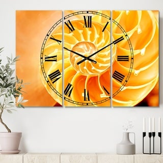 Designart 'Yellow Nautilus Shell' Cottage 3 Panels Large Wall CLock - 36 in. wide x 28 in. high - 3 panels