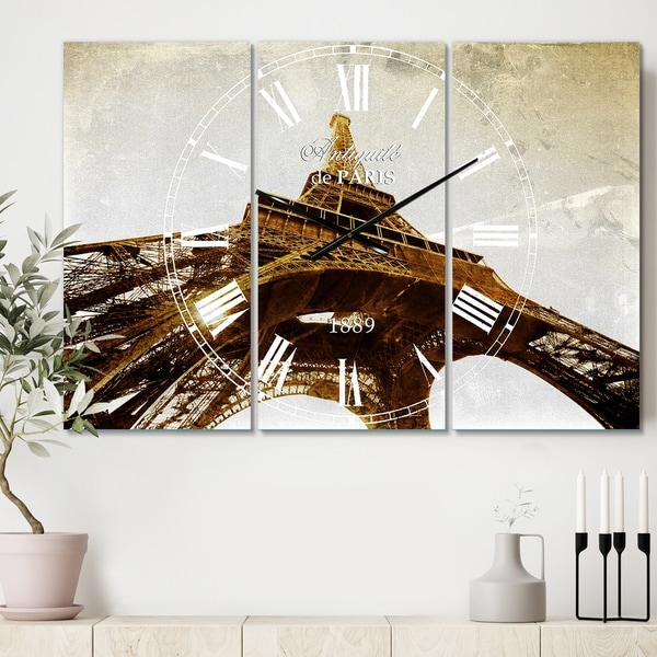Designart 'Paris Eiffel TowerStraight Into Sky' Cottage 3 Panels Large Wall CLock - 36 in. wide x 28 in. high - 3 panels