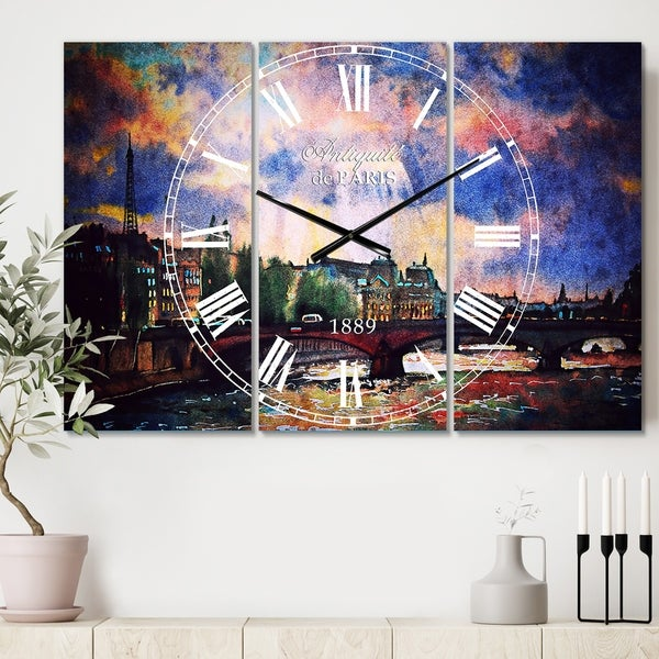 Designart 'Fabulous Paris City Watercolor' Cottage 3 Panels Oversized Wall CLock - 36 in. wide x 28 in. high - 3 panels