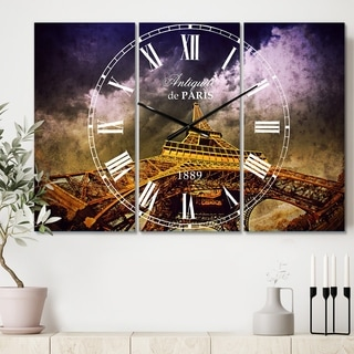 Designart 'Paris Eiffel Towerand Gorgeous Sky' Cottage 3 Panels Oversized Wall CLock - 36 in. wide x 28 in. high - 3 panels