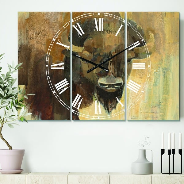 Designart 'Into the Wild Gold Buffalo' Cottage 3 Panels Large Wall CLock - 36 in. wide x 28 in. high - 3 panels