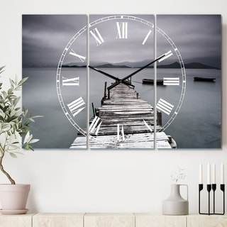 Designart 'Pier and Boats at Seashore' Cottage 3 Panels Large Wall CLock - 36 in. wide x 28 in. high - 3 panels