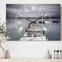 Designart 'Pier and Boats at Seashore' Cottage 3 Panels Oversized Metal Clock - 36 in. wide x 28 in. high - 3 panels