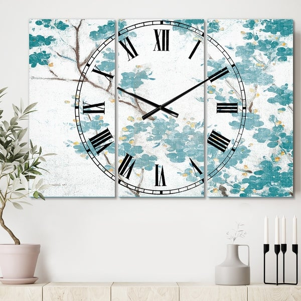Designart 'Teal Cherry Blossoms II' Cottage 3 Panels Oversized Wall CLock - 36 in. wide x 28 in. high - 3 panels