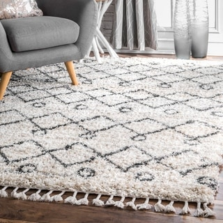 The Curated Nomad Dennis Hollow Geometric Trellis Tassel Shag Area Rug