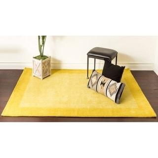 Yellow Solid Bordered Wool Area Rug