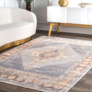 The Curated Nomad Cora Blue Persian Rustic Medallion Floral Border Tassel Area Rug
