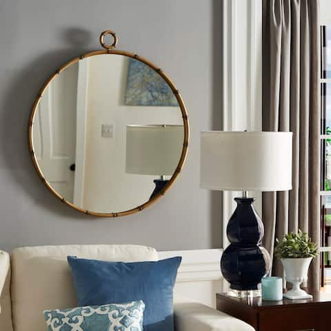 The Curated Nomad Maynard Antiqued Brass Round Wall Mirror with Decorative Ring