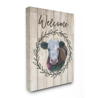 The Stupell Home Decor Welcome Sign Painted Cow with Flower and Wreath Canvas Wall Art, 16 x 20, Proudly Made in USA