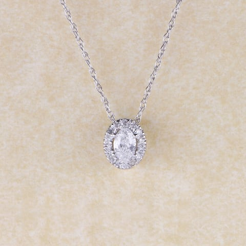 1/6ct TDW Oval Shape Diamond Halo Necklace in 10k Gold by De Couer