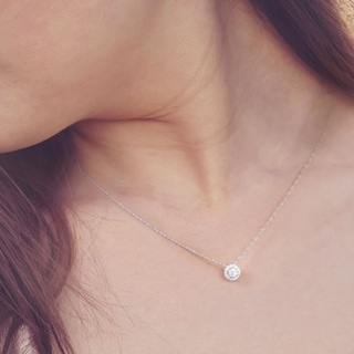 1/6ct TDW Round Shape Diamond Halo Necklace in 10k Gold by De Couer