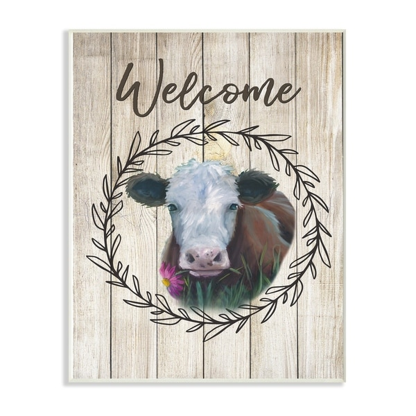 The Stupell Home Decor Welcome Sign Painted Cow with Flower and Wreath Wall Plaque Art, 10 x 15, Proudly Made in USA