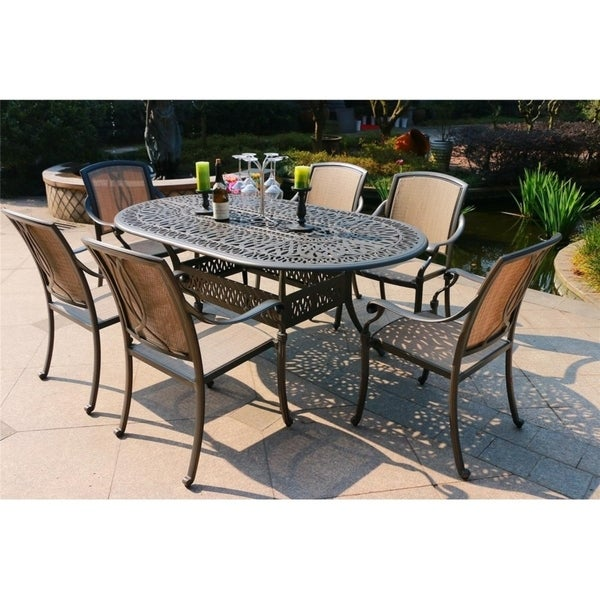 Havenside Home Manasquan 7-piece Gunmetal Aluminum Oval Dining Set with Sling Chairs