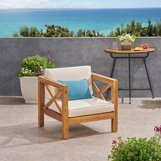 Link to Brava Outdoor Acacia Wood Club Chair with Cushion by Christopher Knight Home Similar Items in Outdoor Coffee & Side Tables