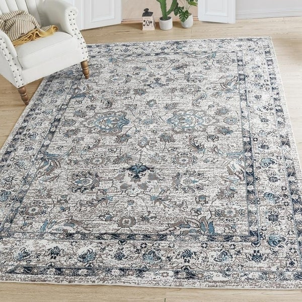 "Indoor Floral Distressed Area Rug - 6'5""x 9'"