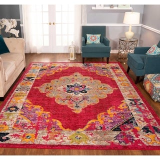 The Curated Nomad Rincon Floral Distressed Fuchsia Rug