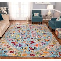The Curated Nomad Rincon Distressed Light Blue Floral Rug