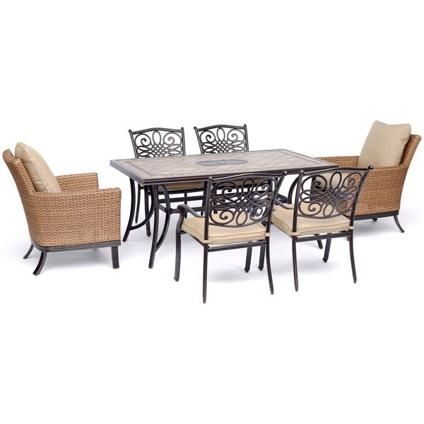 """Hanover Monaco 7-Piece Patio Dining Set with 2 Woven Armchairs, 4 Cast Dining Chairs, and 40"""" x 68"""" Tile-Top Table"""