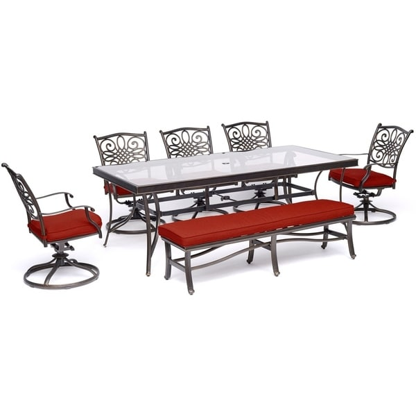 "Hanover Traditions 7-Piece Outdoor Dining Set in Red with 5 Swivel Rockers, a Cushioned Bench, and a 42"" x 84"" Glass-Top Table"