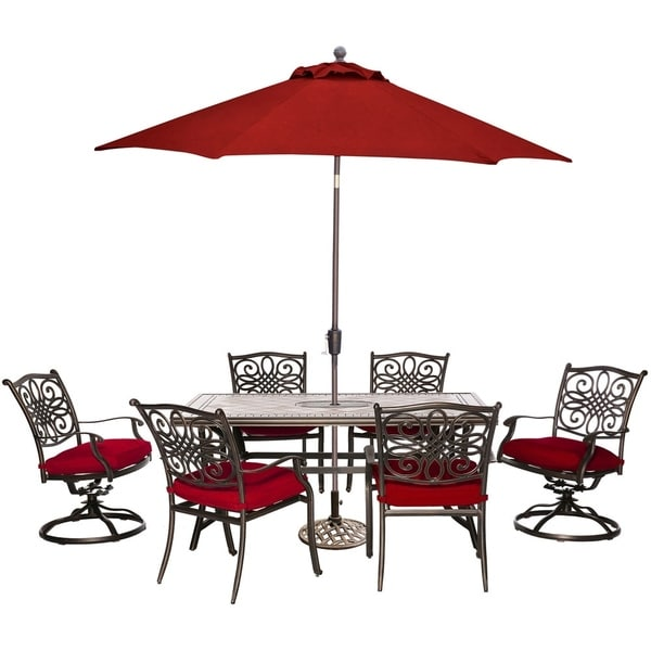Hanover Monaco 7-Piece Patio Dining Set in Red with 4 Chairs, 2 Swivel Rockers, Tile-Top Table, 9-Ft. Umbrella and Stand