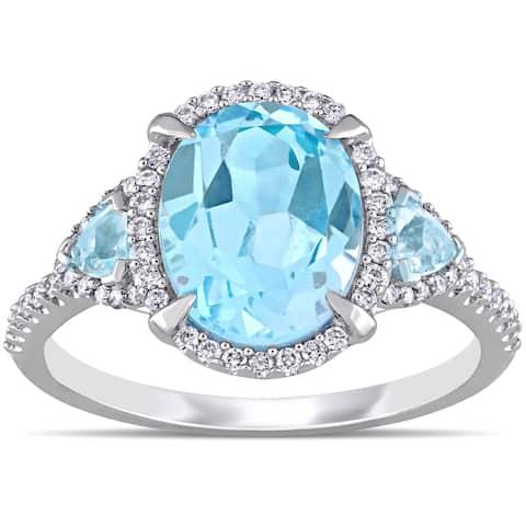Miadora 14k White Gold Sky-Blue Topaz and 1/4ct TDW Diamond 3-Stone Halo Engagement Ring