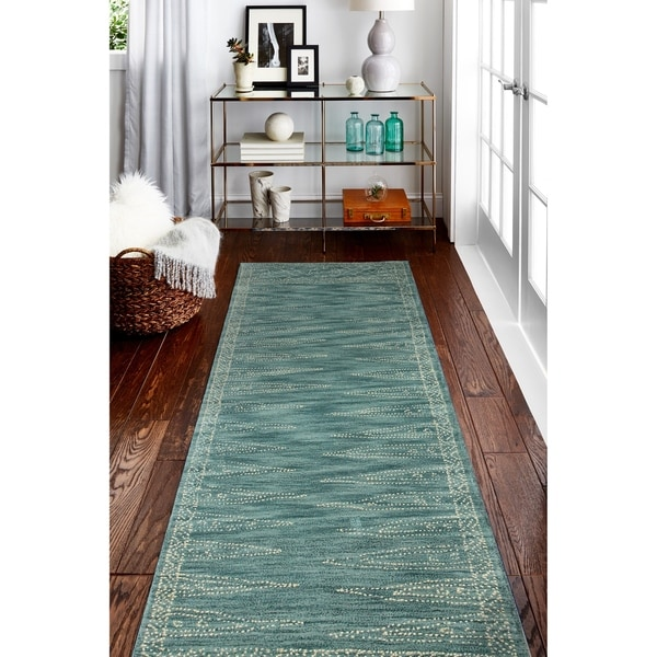Hand Tufted Eloise Teal Rug. Opens flyout.