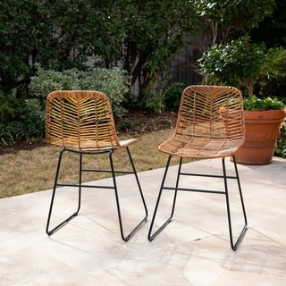 Link to Rialto Modern Natural/ Black Faux Rattan Outdoor Chairs (Set of 2) by Havenside Home Similar Items in Dining Room & Bar Furniture