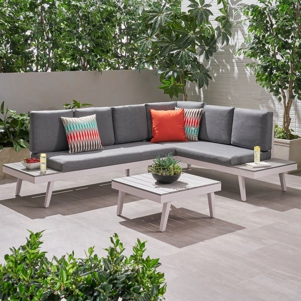 Irma Outdoor Aluminum Sofa Sectional with Faux Wood Accents by Christopher Knight Home. Opens flyout.