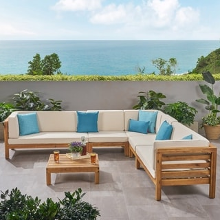 Link to Oana Outdoor 7-seater Acacia Wood Sectional Sofa Set by Christopher Knight Home Similar Items in Patio Sets
