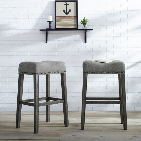 The Gray Barn Overlook Upholstered Backless Saddle Seat Bar Stool in Tan (Set of 2) (As Is Item). Opens flyout.