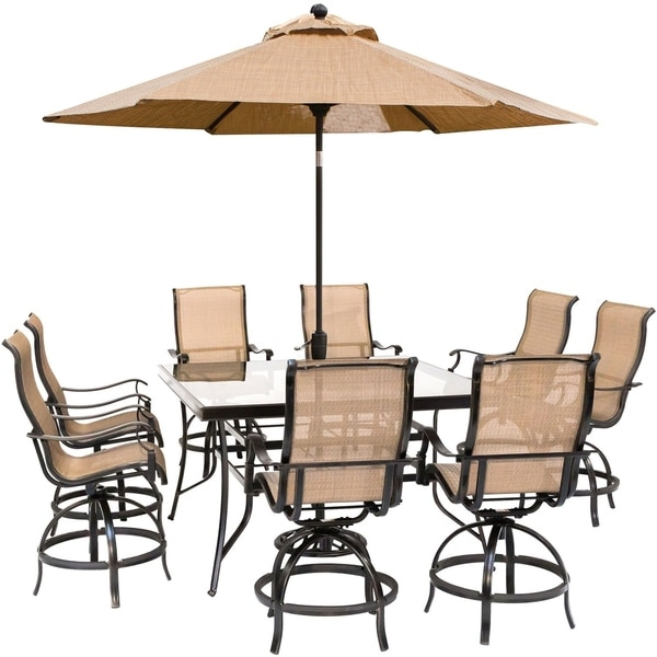 Hanover Monaco 9-Piece Counter-Height Outdoor Dining Set with 8 Sling Swivel Chairs, 60-In. Glass-Top Table, Umbrella and Stand