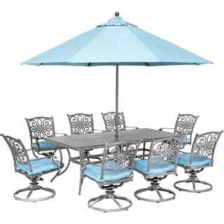 Hanover Traditions 9-Piece Dining Set with 8 Swivel Rockers, 42 x 84 Dining Table, Umbrella and Stand, Blue/Gray