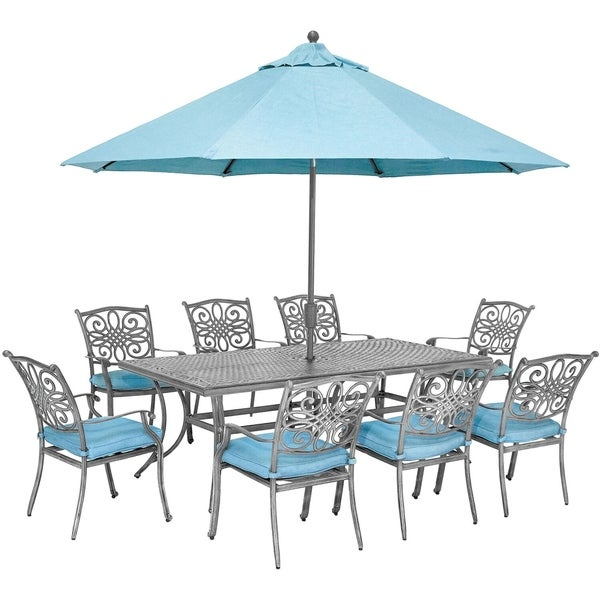 Hanover Traditions 9-Piece Gray Patio Dining Set with 8 Chairs, Blue Cushions, Cast-Top Dining Table, and Umbrella with Stand