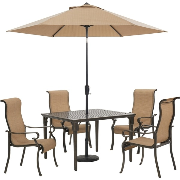 Hanover Brigantine 5-Piece Outdoor Dining Set with 4 Sling Chairs, Square Cast-Top Table, 9-Ft. Umbrella and Base