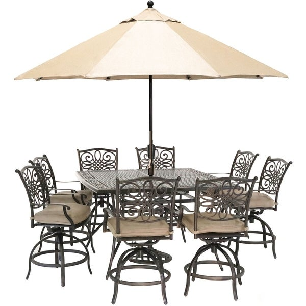 Hanover Traditions 9-Piece High-Dining Set with 8 Swivel Chairs, a 60 In. Square Cast-Top Table, Umbrella and Stand