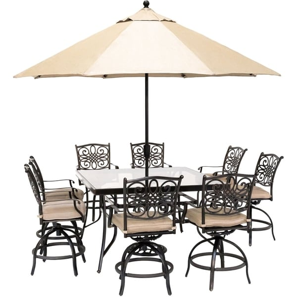 Hanover Traditions 9-Piece High-Dining Set with 8 Swivel Chairs, a 60 In. Square Glass-Top Table, Umbrella and Stand