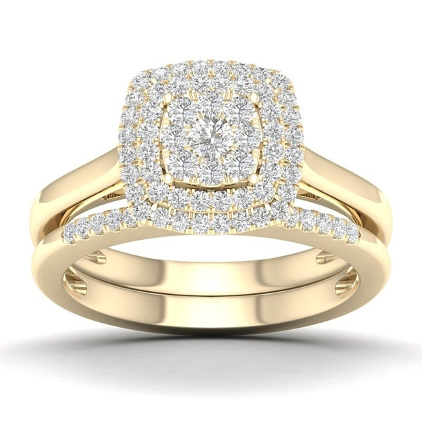 1/2 CT. T.W. Cushion Cluster Diamond Double Halo Bridal Set with two Pink Sapphire in 10K Yellow Gold. Opens flyout.