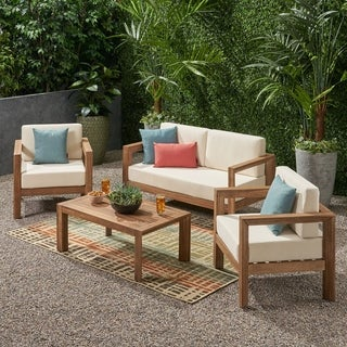 Link to Genser Outdoor 4 Seater Acacia Wood Chat Set by Christopher Knight Home Similar Items in Outdoor Sofas, Chairs & Sectionals