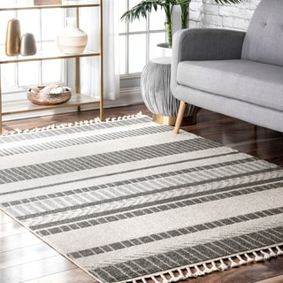 The Curated Nomad Louisburg Contemporary Striped Outdoor Tassel Area Rug