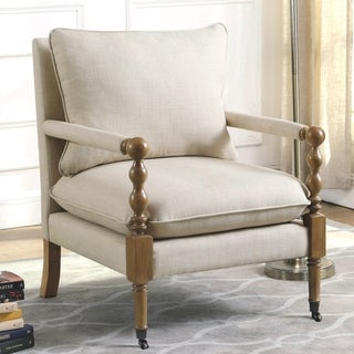 Vintage Inspired Beige Upholstered Accent Chair with Decorative Casters
