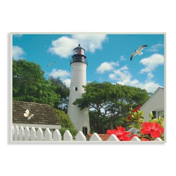 The Stupell Home Decor Key West Light House With Picket Fence Butterfly And Seagull Wall Plaque Art 10x15 Proudly Made In Usa